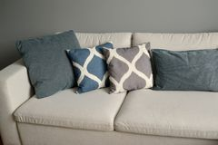 Sofa with throw pillows. Living room interior fragment.  stock photography