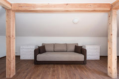 Sofa with two cabinets in the attic Stock Photography