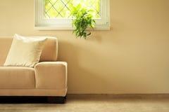 Sofa under window Stock Images