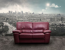 A sofa on a urban background Stock Image