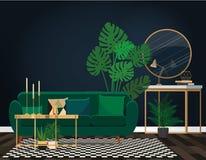 Sofa vert contre un mur bleu-foncé avec un miroir photos libres de droits