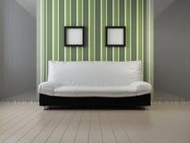 Sofa at a wall Royalty Free Stock Photography