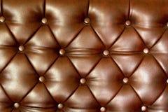 Sofa wall vintage brown. Surface of vintage brown sofa Royalty Free Stock Photo