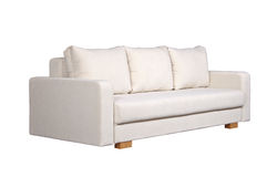 Sofa with white fabric upholstery (side view). A sofa with white fabric upholstery isolated on white background Stock Images