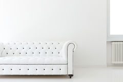 Sofa in white room Royalty Free Stock Image