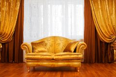 Sofa at a window. Beautiful sofa at a window in a modern apartment Royalty Free Stock Photography