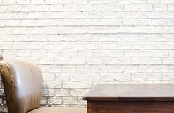 Sofa and wood table and white brick wall Royalty Free Stock Images