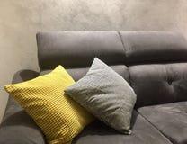 Sofa with yellow and grey pillows. Pesaro, Italy Royalty Free Stock Photo