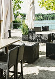 Sofas and chairs on the sand at lake shore Royalty Free Stock Photo