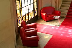 Sofas stained glass. Sofas in waiting area with stained glass window Royalty Free Stock Photo