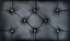 Soffa-typ screed Retro mörk chesterfieldsoffastil vadderade upp stoppningbakgrundslut Svart capitonemodelltextur arkivbilder