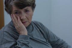 Sofferenza senior per la depressione Immagini Stock