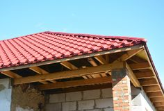 Soffit and Fascia installation. Roofing house construction and insulation detail. Metal roof. Stock Images