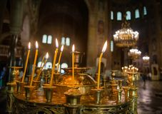 Candles inside a Bulgarian Orthodox church royalty free stock image
