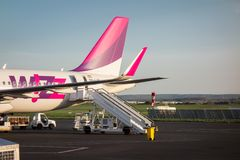 Sofia , Bulgaria - APRIL 15, 2015: Airplane is near the terminal gate ready for takeoff. Crew is preparing the plane for flight. W. Izzair is a rapidly growing Stock Photography