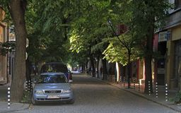 People are walking by the narrow street in Sofia, Bulgaria Stock Image