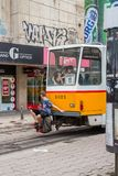SOFIA, BULGARIA - JULY 15, 2017: Unidentified young boy hitches a ride on a tram stock photos