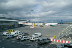 SOFIA,BULGARIA - NOVEMBER 13, 2016: Exterior of Sofia International Airport with plane and support vehicles. Exterior of Sofia International Airport with plane stock images