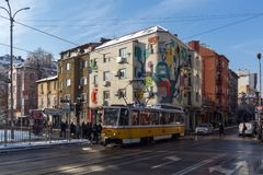 People and tram at Graf Ignatiev street in Sofia, Bulgaria. SOFIA, BULGARIA - NOVEMBER 29, 2017: People and tram at Graf Ignatiev street in Sofia, Bulgaria Royalty Free Stock Image