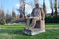 Sofia / Bulgaria - November 2017: A Soviet-era sculpted figure of Vladimir Lenin in front of the museum of socialist arts royalty free stock image