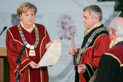 Bulgaria Merkel Doctor Honoris Title. Sofia, Bulgaria - October 11, 2010: German Chancellor Angela Merkels smiles as she receives the doctor honoris causa title royalty free stock image
