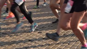 Marathon runners legs only. 4k. Sofia, Bulgaria - 13 October 2019: Men and women run during a start of Sofia Marathon running race. Legs and bodies only stock video