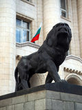Sofia Bulgaria statue lion Court of Justice with Bulgarian natio. Nal flag in window Royalty Free Stock Images