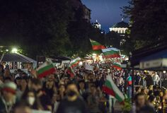 Sofia, Bulgaria - Jul 16 2020: People protesting in front of National Assembly carrying national flags and demanding PM's
