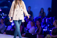 Sofia Fashion Week female blue jeans. A female model walks the runway during the Autumn/Winter Sofia Fashion Week Show 2016 in Sofia, Bulgaria. blue jeans royalty free stock photos