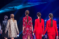 Sofia Fashion Week female models backs red suits. AFemale model are standing in line at the runway during the Autumn/Winter Sofia Fashion Week Show 2016 in Sofia royalty free stock images