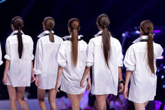 Sofia Fashion Week female models backs. Female models are standing in line at the runway during the Autumn/Winter Sofia Fashion Week Show 2016 in Sofia, Bulgaria Stock Photography