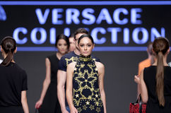 Sofia Fashion Week female Versace. Sofia, Bulgaria - September 12, 2016: A female model walks the runway during the Autumn/Winter Sofia Fashion Week Show 2016 in stock photography