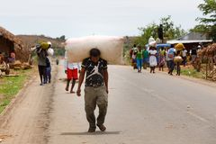 Malagasy man transport cargo on head Royalty Free Stock Images