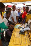 Man sell cellular phones on rural Madagascar marketplace Stock Photography
