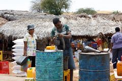 Man sell petrol on rural Madagascar marketplace Stock Images