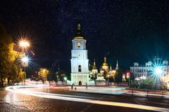 Sofia square at night. Sofia square in the center of Kiev at night with light trails from the cars and starry sky. Ukraine, Europe Stock Image