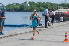Sofiia Tkach competing at the women`s race during Dnipro ETU Triathlon Junior European Cup. DNIPRO, UKRAINE - June 03, 2018:Sofiia Tkach competing at the women`s stock photography