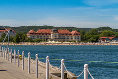 Sofitel Grand Sopot Hotel and beach. SOPOT, POLAND - JUNI 6: View of the Sofitel Grand Hotel and beach from the wooden pier in Sopot, Poland on Juni 6, 2015 royalty free stock photo