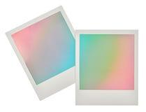 Sofortige Fotorahmen mit Pastell farbigem Hintergrund Stockfotografie