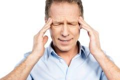 Sofrimento da dor de cabeça Fotos de Stock Royalty Free