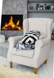 Soft armchair near the fireplace Royalty Free Stock Image