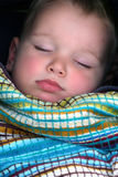 Soft baby skin Portrait. Little boy sleeping soft focus. Sharp on eyes nose and lips. heart  shaped mouth Royalty Free Stock Images