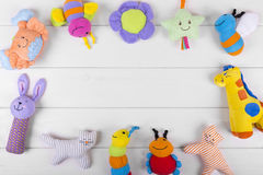 Soft baby toys on wooden background with copy space Stock Photo