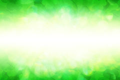 Soft Background with Shamrock. Soft green background with shamrock leaves and rays Stock Image