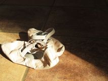 Ballet slippers in the light royalty free stock photo