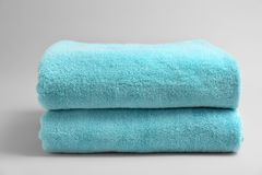 Soft bath towels. On grey background Stock Photography