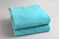 Soft bath towels. On grey background Stock Photos