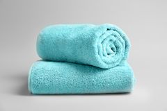 Soft bath towels. On grey background Royalty Free Stock Photography