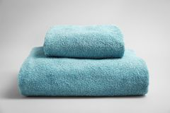 Soft bath towels. On grey background Stock Images