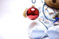 Soft bear with Christmas ball. Soft bear with hanging red Christmas ball royalty free stock photography